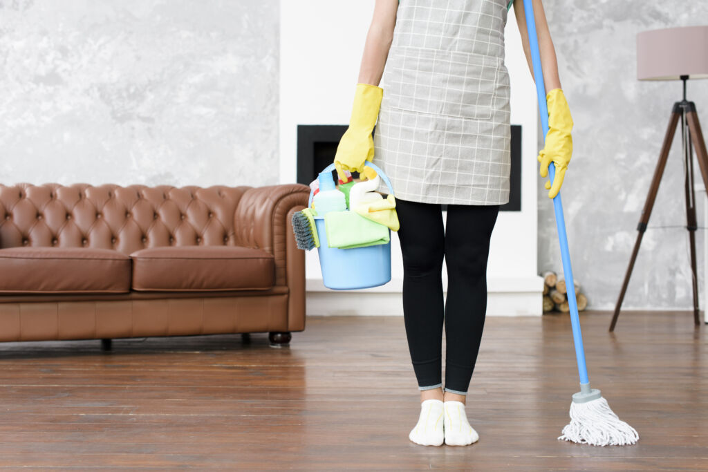 Woman Sanitizing & Cleaning Home In Singapore